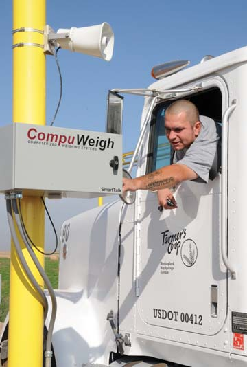 A trucker on the unattended outbound scale has a question and uses the SmartTalk intercom system to call the control room.